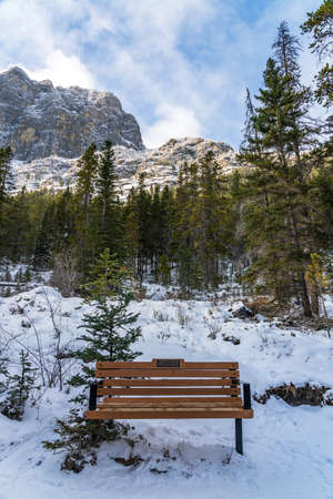 Canmore, AB, Canada-OCT 24 2020: Grassi Lakes Trail in early winter season sunny day morning.