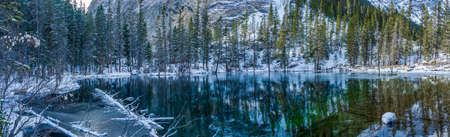 Panorama view of Lower Grassi Lakes in winter season. The reflection of the lake surface like a mirror. Canmore, Alberta, Canada. Stock fotó