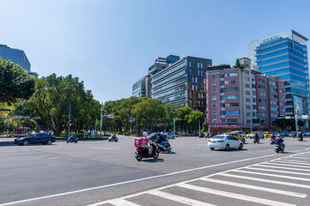 Taipei, Taiwan-FEB 14, 2021: Street view of Taipei City, the intersection of Minquan East Road and Dunhua North Road, near Songshan Airport.