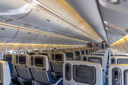 Boeing 767-300 aircraft cabin economy class seats with touch screen. By All Nippon Airways (ANA ).