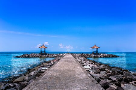 Love heart at the end of a pathway at Candidasa Beach in Bali, Indonesia