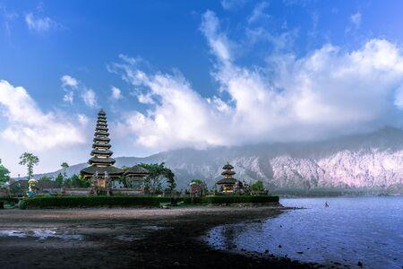 Dry season at Ulun Danu Beratan Temple with a blue cloudy sky in Bali, Indonesia