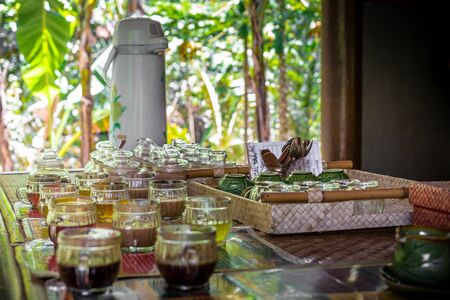 Selection of coffee with different flavours in mugs at a coffee plantation in Bali, Indonesia Stock Photo