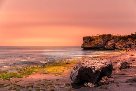 Sunset view of cliffs at Balangan beach in the Kuta area of Bali, Indonesia Stock Photo