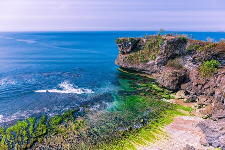 Aerial view of cliffs at Balangan beach in the Kuta area of Bali, Indonesia