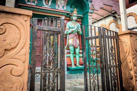 Open gates in front of the Hanuman Hindu green monkey god sculpture outside the entrance of the Sri Vadapathira Kaliamman Temple on Serangoon Road in Little India, Singapore, Asia