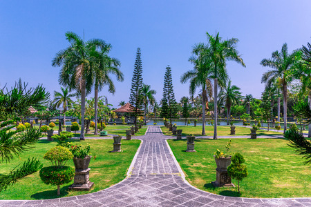 Views of a pathway in the garden at Ujung Water Palace (also known as Ujung Park or Sukasada Park) in Bali, Indonesia
