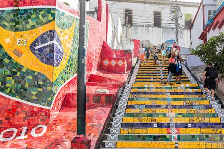 Mural on the Lapa steps with tourists walking up & down the staircase in the urban, colorful and cool Lapa neighbourhood of central Rio de Janeiro in Brazil, South America Redakční