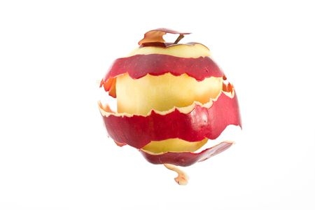 Peeled apple with apple skin freely floating around it