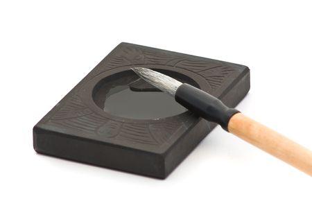 sumi: Closeup of calligraphy brush over white background  Stock Photo