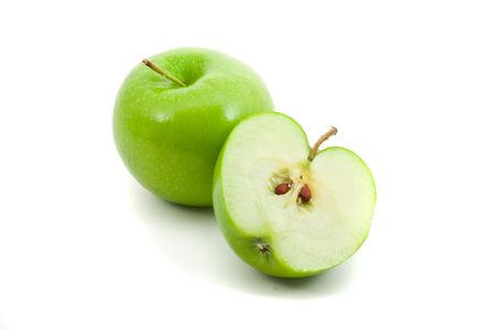 Green apple whole and cut in half over white background Stock Photo