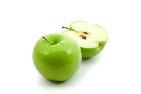 Green apple whole and cut in half over white background Stock Photo - 6731615