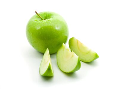 Green apple with slices over white background Stock Photo - 6731616