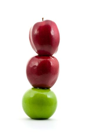 Stack of red and green apples over white background Stock Photo - 6731586