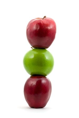 Stack of red and green apples over white background Stock Photo - 6731614