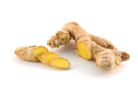 Sliced fresh ginger over white background photo