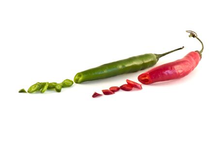Sliced red and green peppers over white background photo