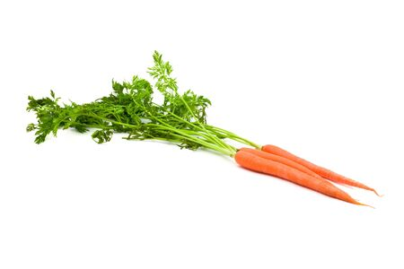 Three beautiful carrots including green over white background photo