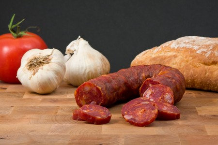 portuguese: Tasty italian chorizo sausage and bread snack Stock Photo