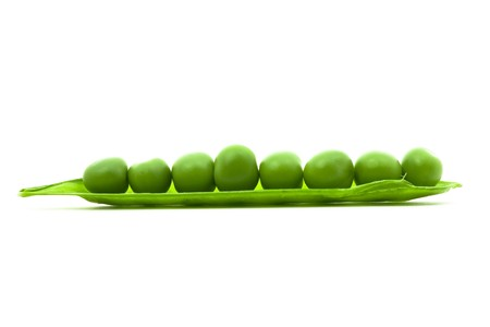 Close up of sugar peas over white background photo