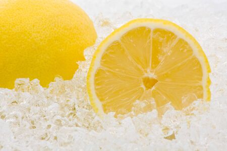 Whole and cut lemons on crushed ice photo