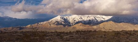Snow covered mountains in the Mojave desert, California photo