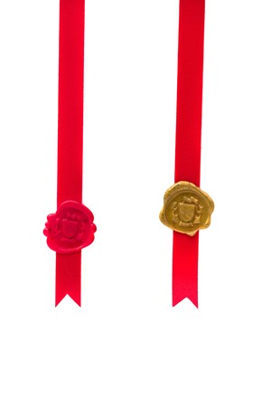 Red and gold wax seal with ribbon over white background Stock Photo - 7136029