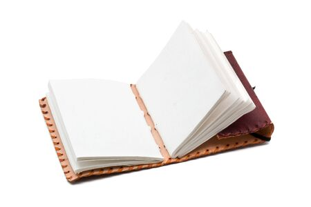 Notebook opened with blank pages over white background photo