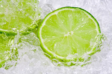 crushed ice: Slices lime with crushed ice on white background Stock Photo