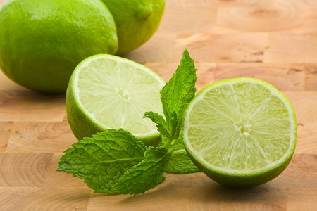 Limes whole and cut with mint leaves Stock Photo - 7164894