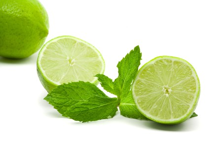 Limes with mint leaves over white background Stock Photo - 7164883