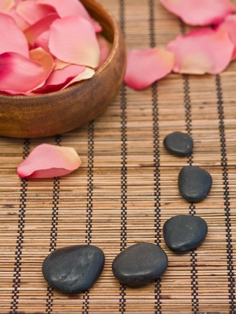 pebblestone: Spa concept of aromatherapy with rose petals and pebbles Stock Photo