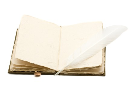 Vintage notebook opened with quill over white background photo