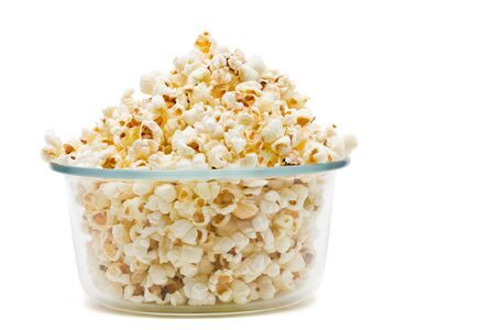 bowls of popcorn: Delicious popcorn in glass bowl over white background