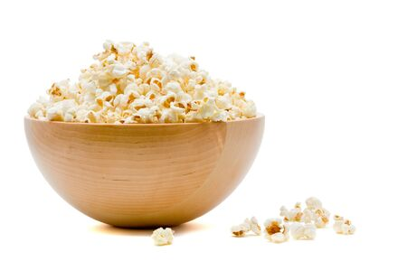 corn kernel: Delicious popcorn in bowl over white background