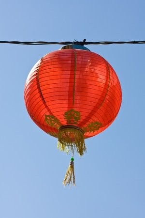 Bright red chinese lantern over blue sky photo