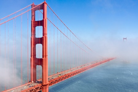 Famous Golden Gate Bridge in San Francisco partly covered in fog photo