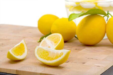 Fresh organic lemons with leaf over white background Stock Photo - 7403745