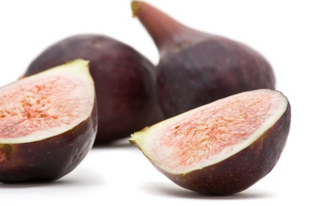 Closeup of delicious organic figs over white background Stock Photo - 7403735