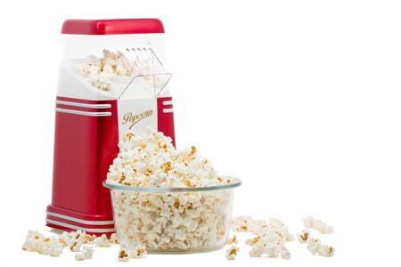 popcorn bowls: Popcorn machine with popcorn over white background