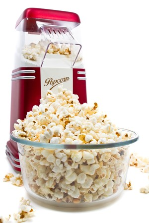 maker: Popcorn machine with popcorn over white background