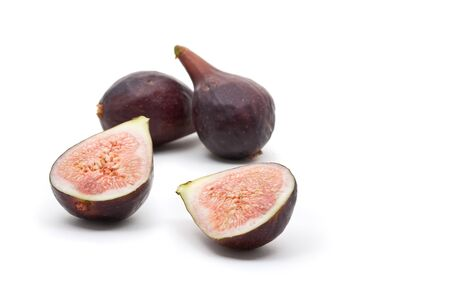 Figs whole and half over white background Stock Photo - 7403852