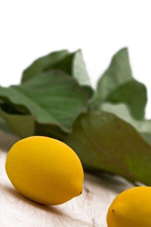 Fresh organic lemons with leaves on wood background Stock Photo - 7403855