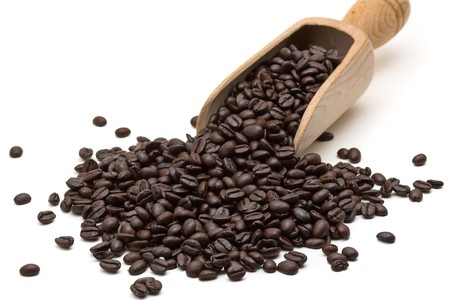 wooden scoop: Coffee beans poured from wooden scoop over white background Stock Photo