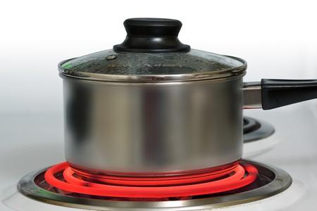 acier bross�?: Bross� acier pot sur rouge cuisini�re �lectrique hot
