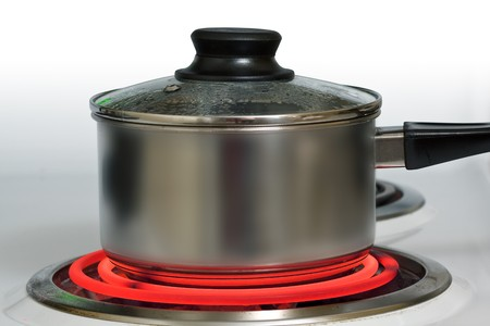 stove: Brushed steel pot on red hot electric stove