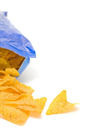 Opened pack of delicious spicy nachos over white background photo