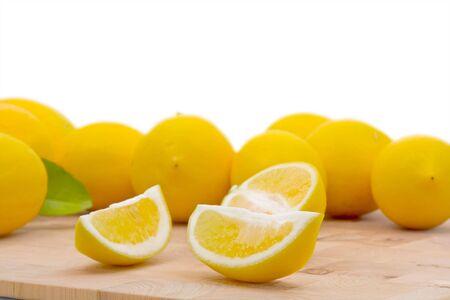 Fresh organic lemons with leaf over white background Stock Photo - 7493273