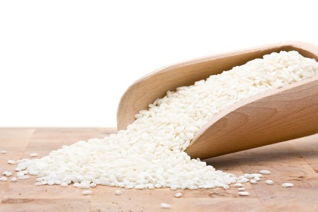 basmati: Basmati rice in wooden scoop on table Stock Photo