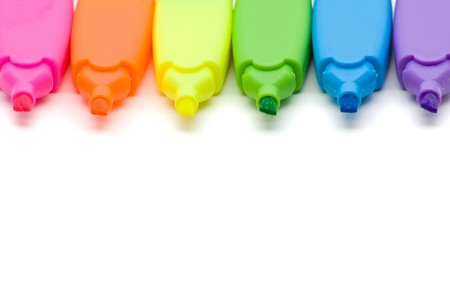 Colorful text markers in different colors over white background photo
